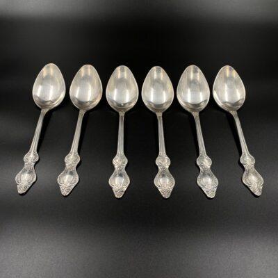 sidabrinių šaukštų komplektas