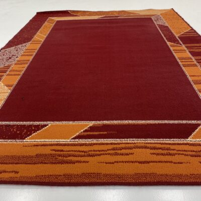 naudotas vilnos kilimas ornažiniais apvadais raudonu centru