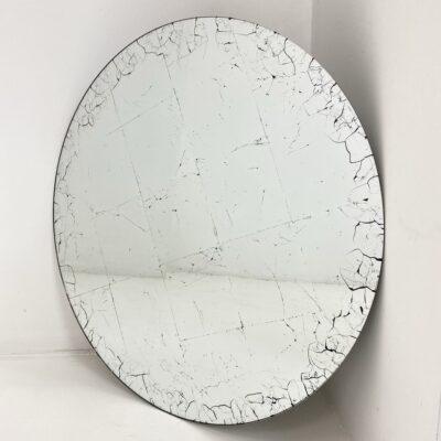 apvalus veidrodis su piešiniu