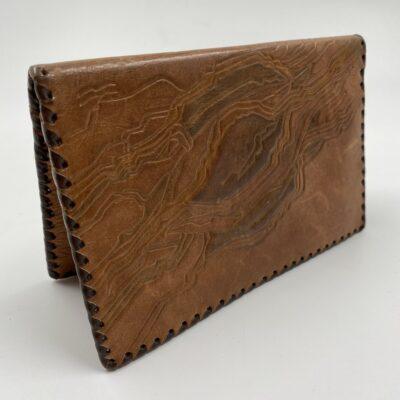 Naudota ruda odinė piniginė