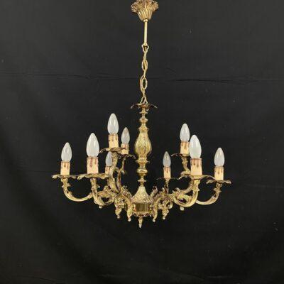 Baroko stiliaus devynių lempų bronzinis sietynas