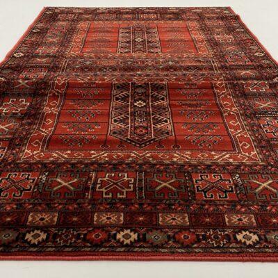 Raudonas Bukhara raštų vilnos kilimas dekoruotas geometriniais ornamentais