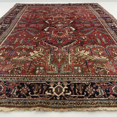 Raudonas persiškas rankų darbo vilnonis kilimas dekoruotas geometriniais ornamentais