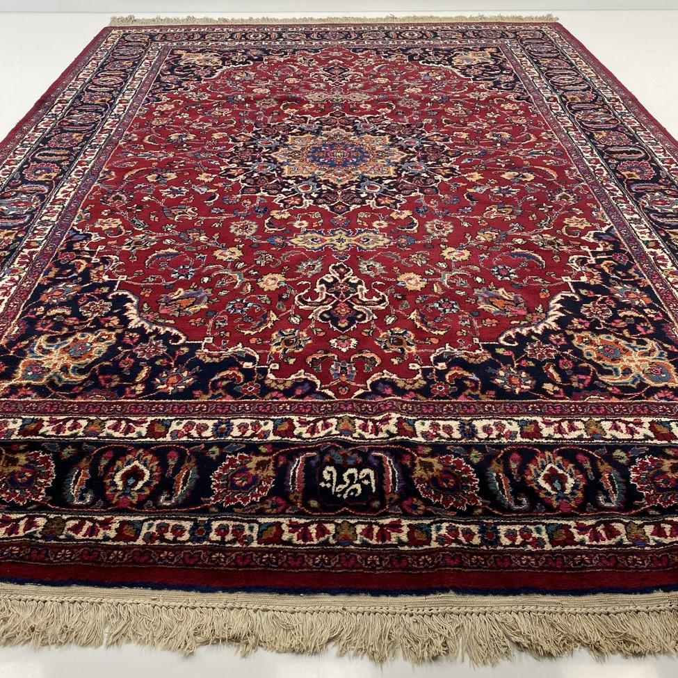 Mėlynas margas persiškas rankų darbo vilnonis kilimas dekoruotas augaliniais ornamentais